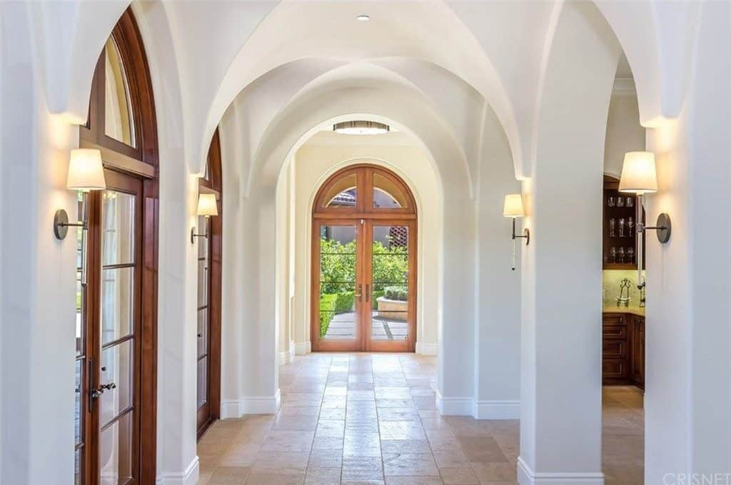The hallway featuring groin vault ceiling leads to the home's great room and kitchen.
