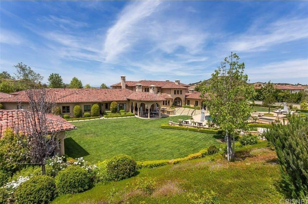 Aerial view of the property's beautiful garden and Mediterranean style home.