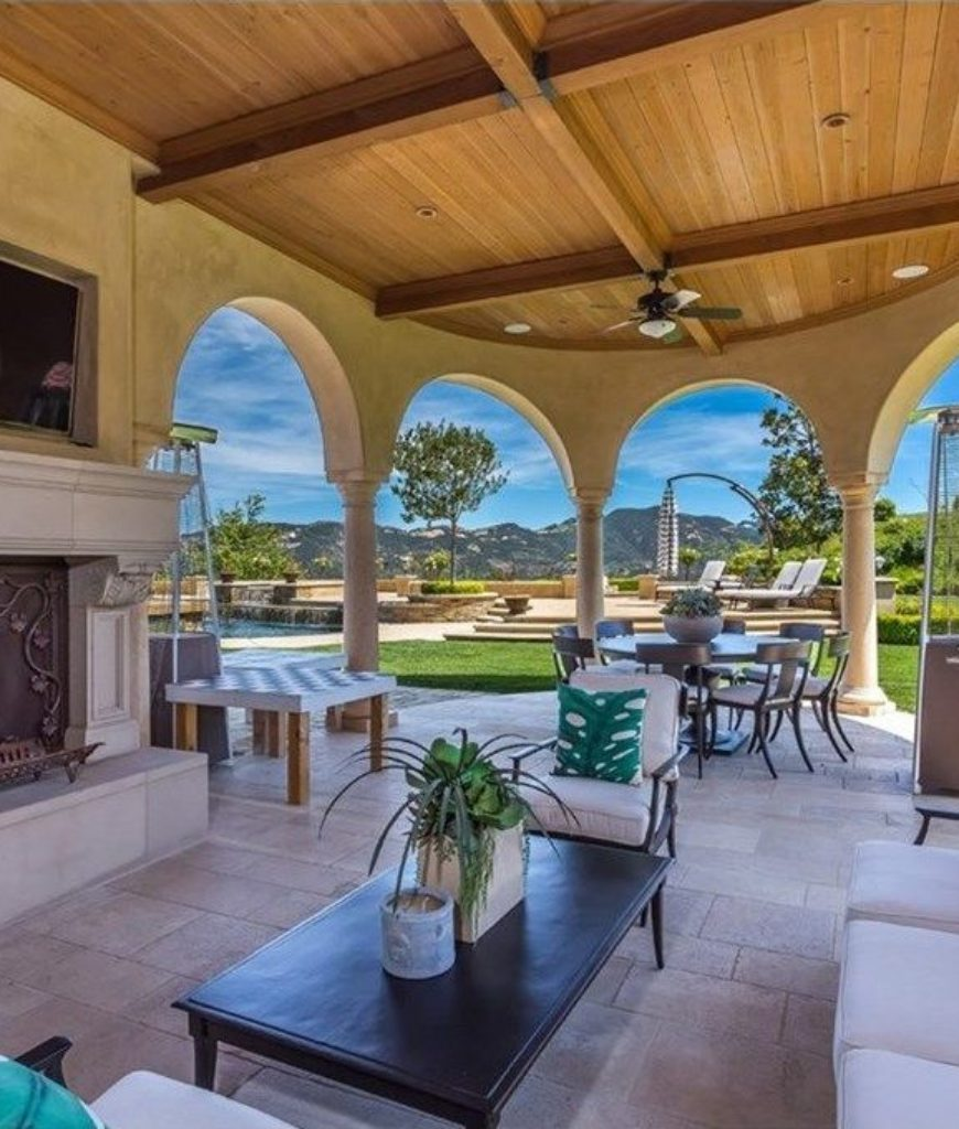 The patio area offers a nice sitting place, a dining area and a barbeque island.
