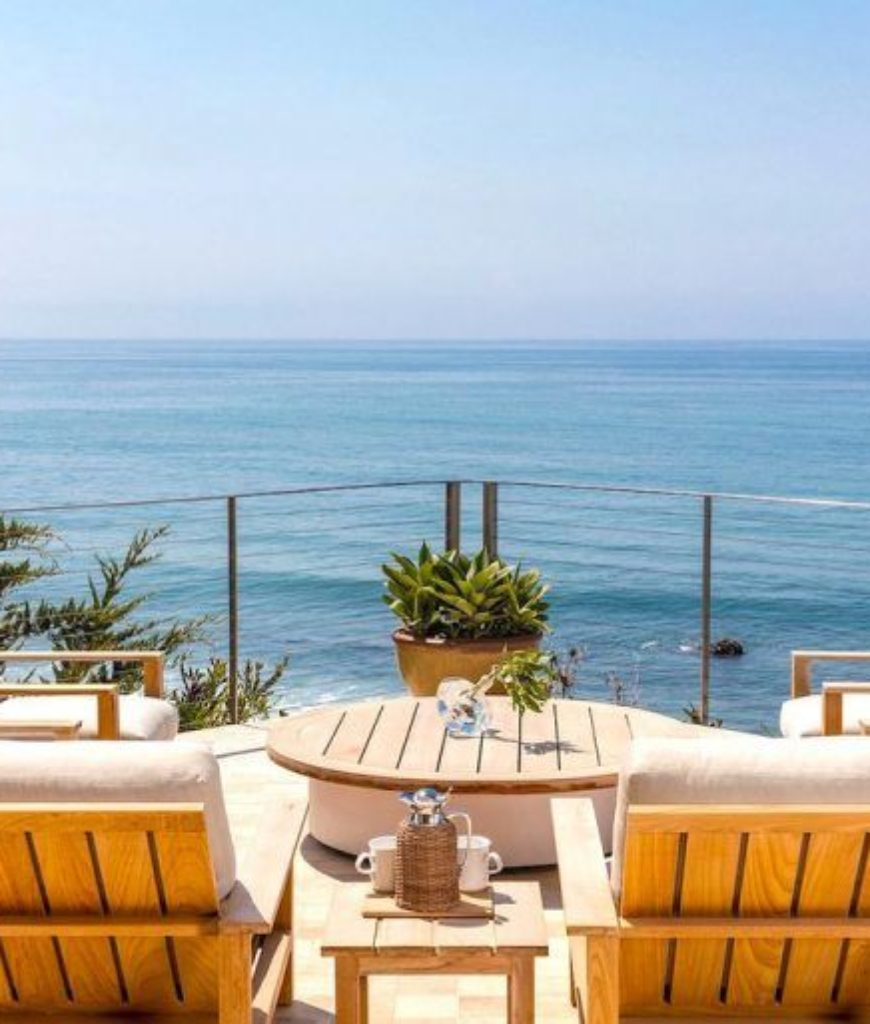 The home's patio overlooks the beautiful ocean view.