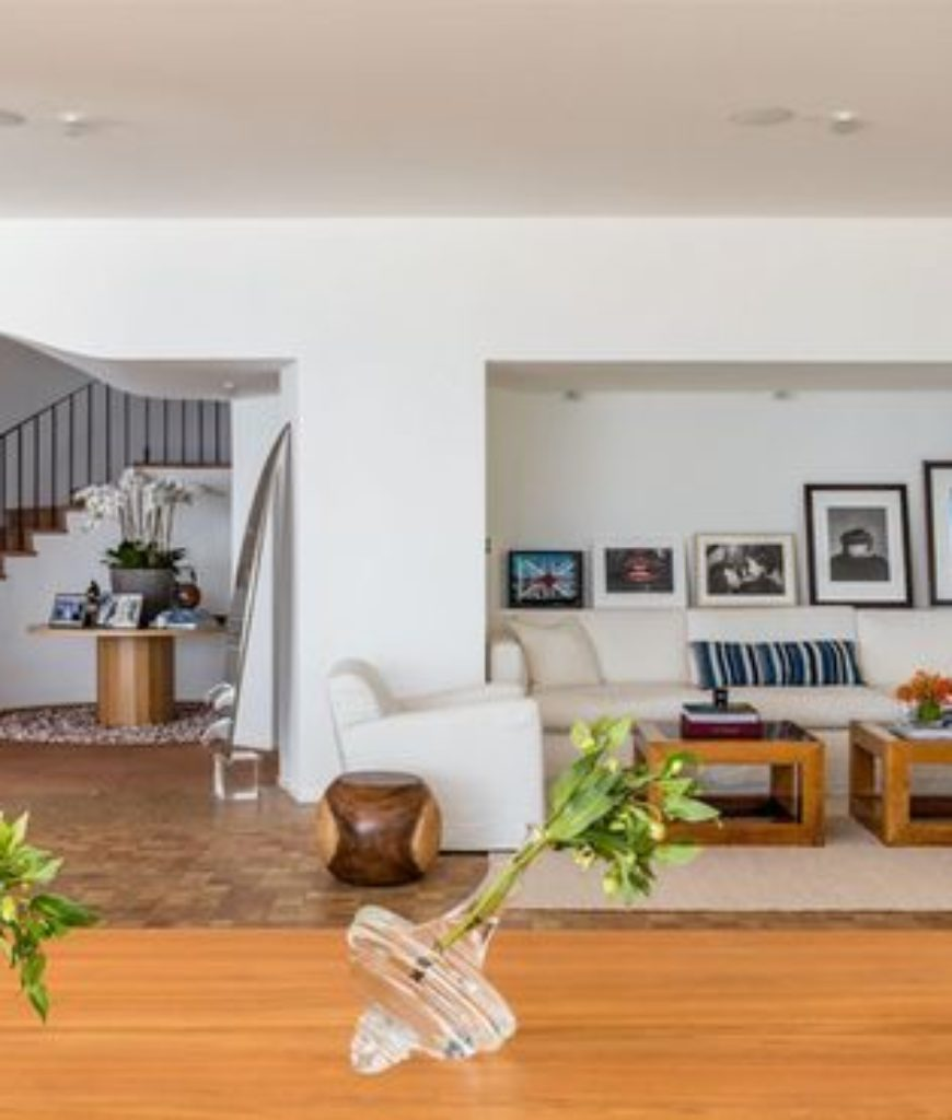 Another view of the home's living spaces and dining area showcasing a traditional look.
