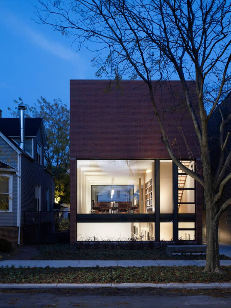 A modern house with exteriors made of red bricks.