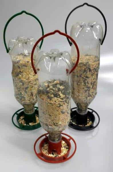 Clear, soda bottles turned into an efficient bird feeder.