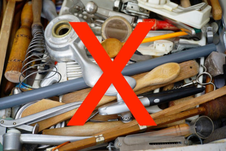 Example of a cluttered kitchen cooking utensil drawer