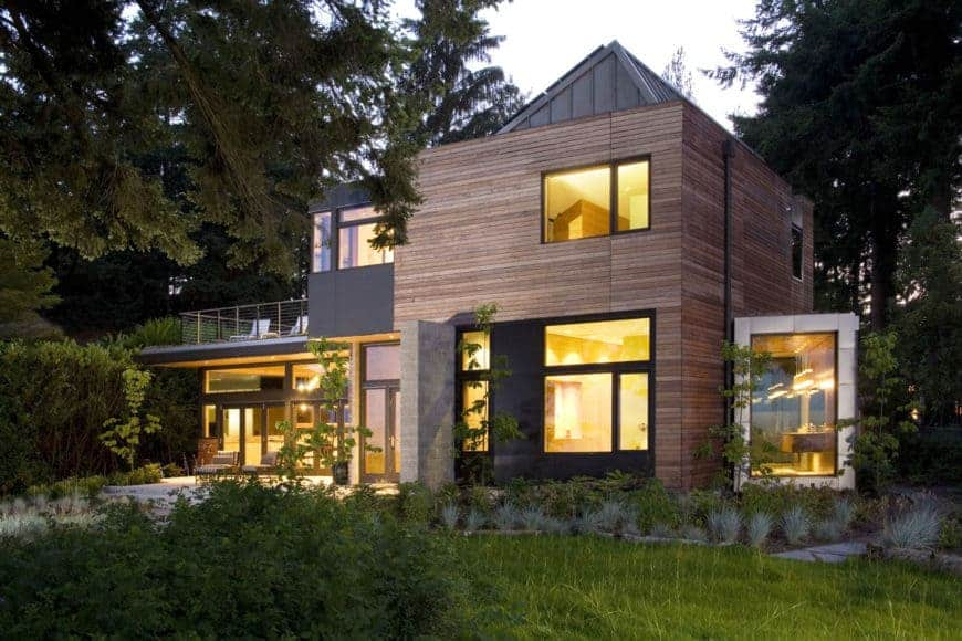 A modern house surrounded by the woods. It has a beautiful interior.