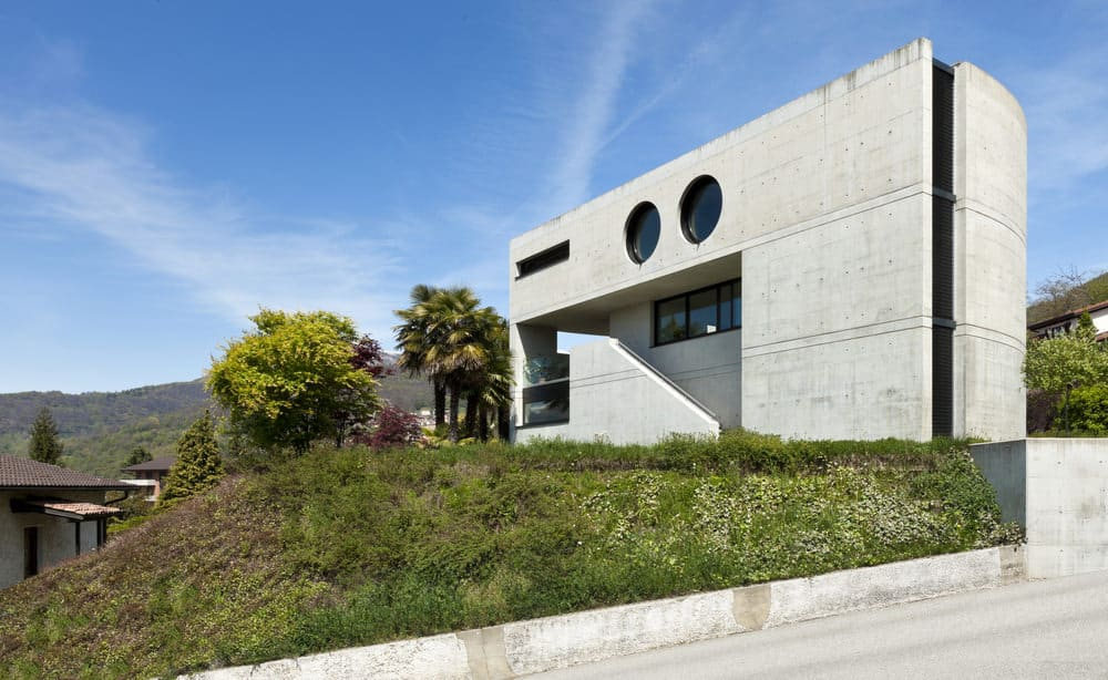 Interesting modern concept home with an exterior entirely in concrete. The shape is rounded on the side which makes it a very interesting looking home.
