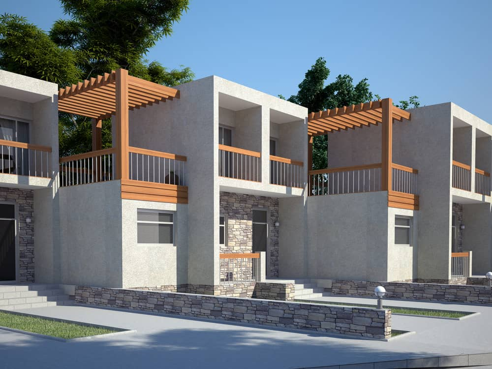 Concrete exterior townhouses with wood balcony makes for a stylish set of townhomes. The overall exterior works well.