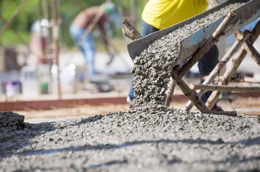 Concrete pour from cement truck at a construction site