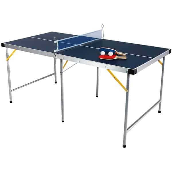 Blue conversion ping-pong table with rackets and balls isolated on white background.