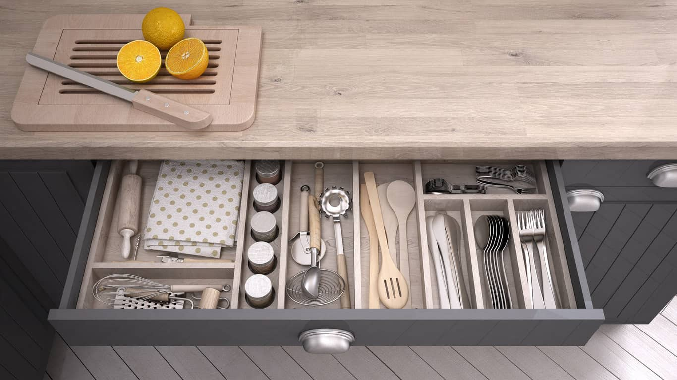 Kitchen utensil drawer with built-in dividers.