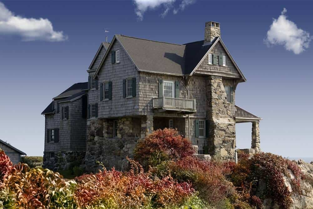 A stone house looking old but sturdy with its all-granite exterior.