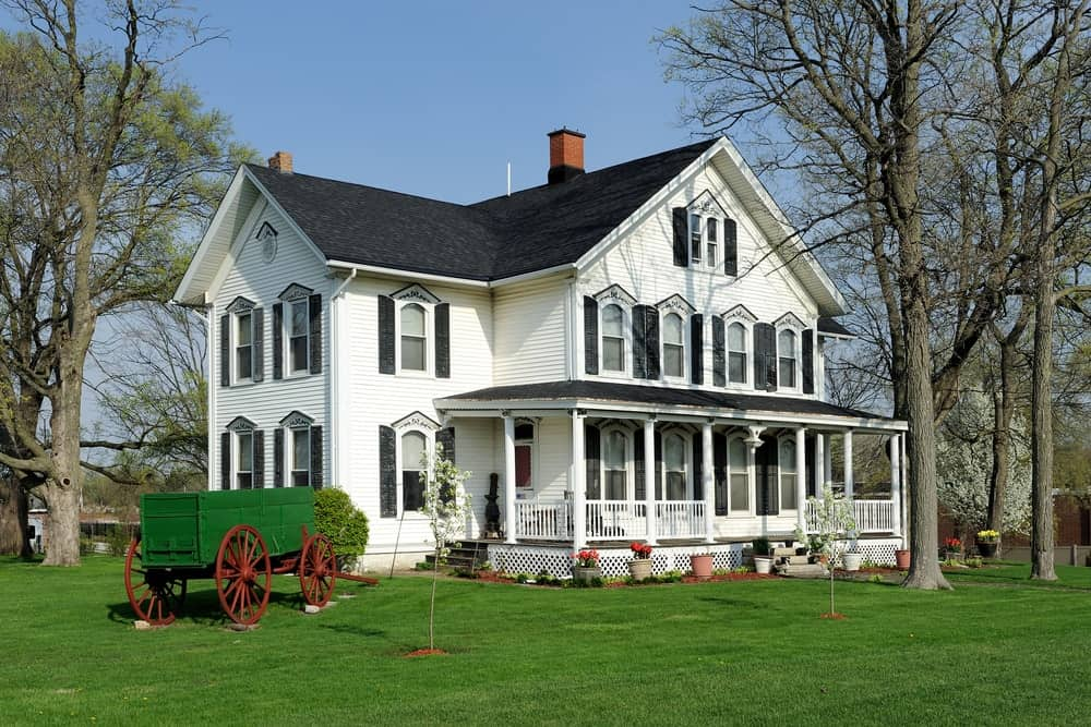 Countryside with spacious lawn, multilevel interior and front porch.
