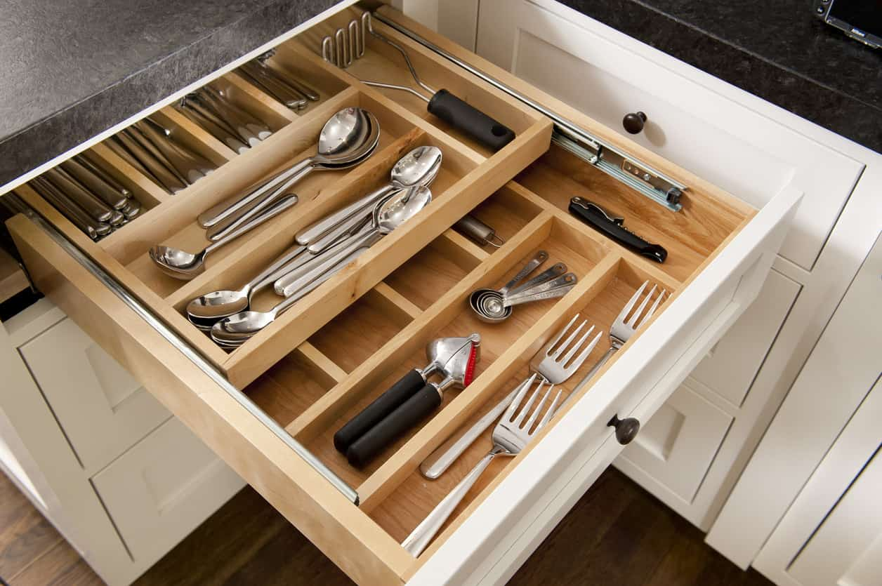 Custom built dining utensil drawer with multiple compartments and two levels