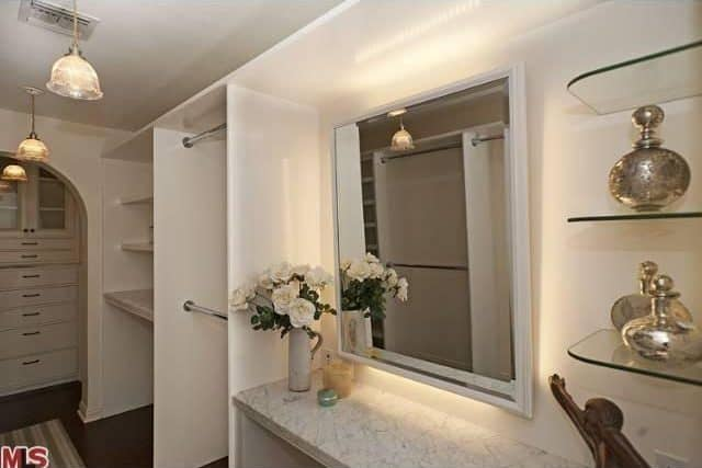 There's a huge closet too featuring multiple cabinetry and shelves lighted by beautiful pendant lights.