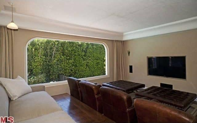 The Home Theater In The Second Floor Features Spanish Style Theater Seating  And A Wide Window
