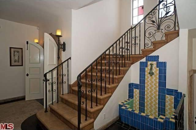 The home features a Spanish style staircase leading to the home's second floor.
