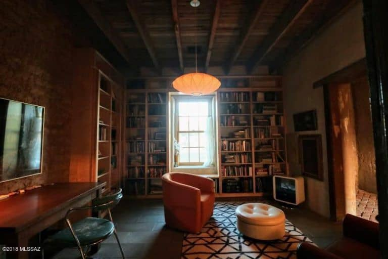 The home also has a reading room boasting a tall and wide bookshelf with a pendant lighting.