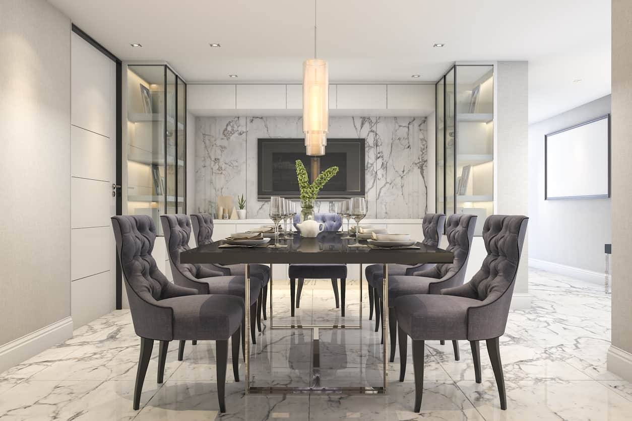 If you like marble, this is the dining room for you with marble floor and accent marble wall. The light floor, wall and ceiling are contrasted with the black dining table and dark gray upholstered dining room chairs.