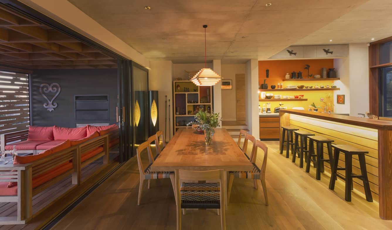 Fabulous casual home decor with long light wood dining table that seats 8 people. The dining area is adjacent to the kitchen which has a long breakfast bar. This room could easily accommodate 13 plus people for dinner.