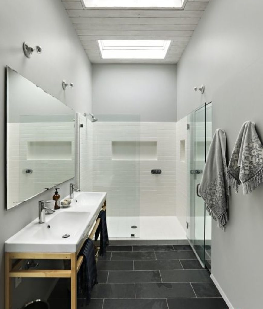 The bathroom is complete with a bathtub, shower area and sink.