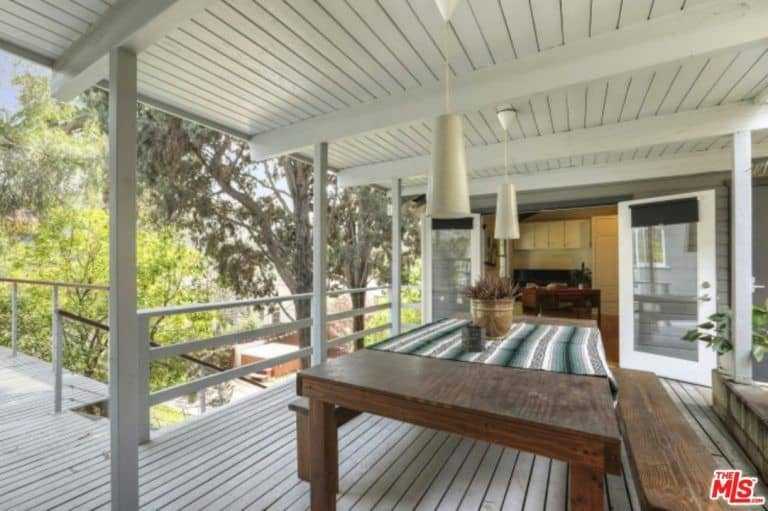 The deck outside also offers a dining table set with bench seating.