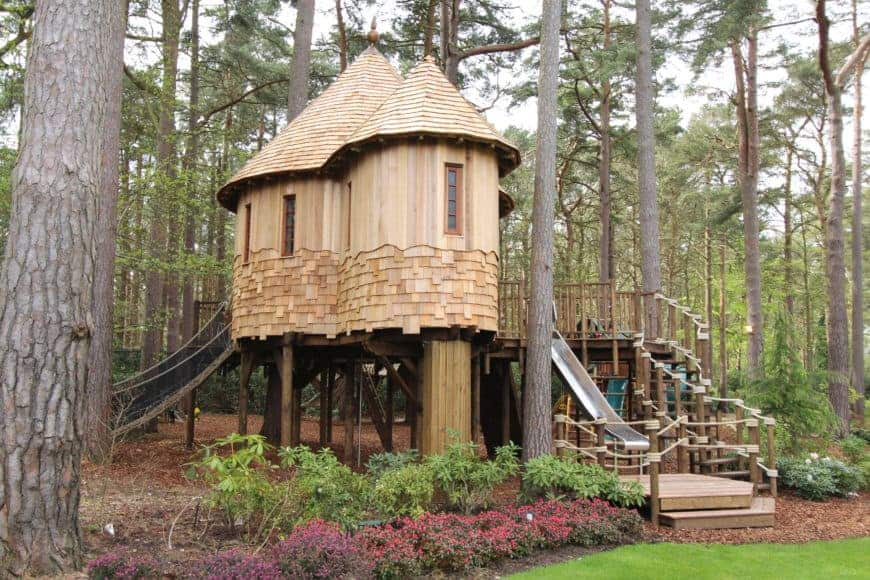 This treehouse looks absolutely enchanting. It is surrounded by tall and mature trees.
