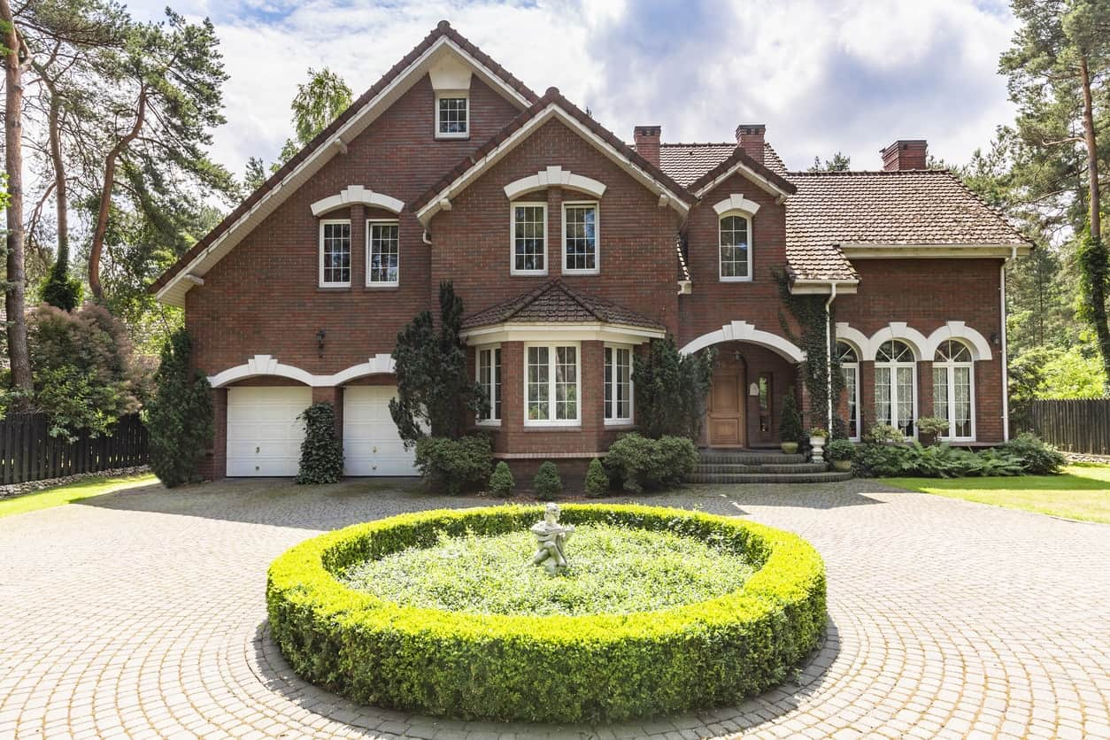 English style classic mansion with circular brick driveway.