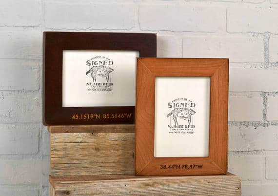 Wooden frame engraved with coordinates of a certain location.