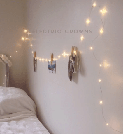 Fairy string lights on wall in bedroom