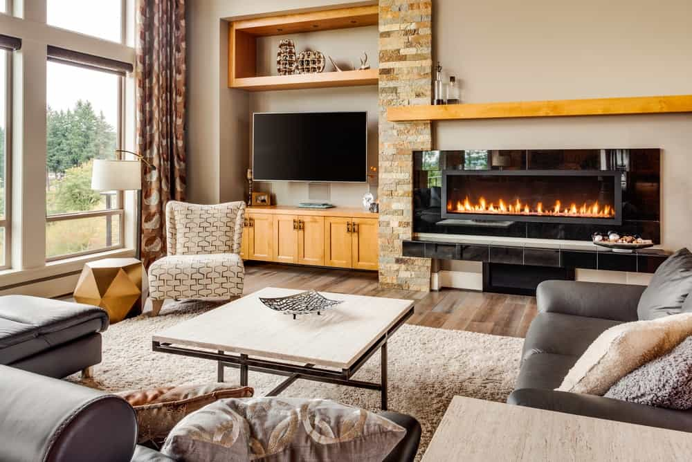 A family room with electric fireplace, perfect for family entertainment session.