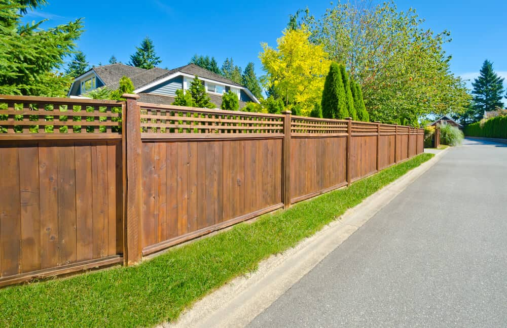 Tall, wooden fences on the lawn.