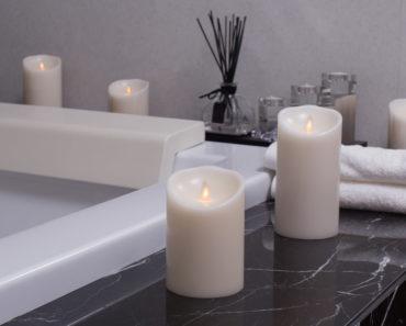 Flameless battery-powered candles on bathtub ledge