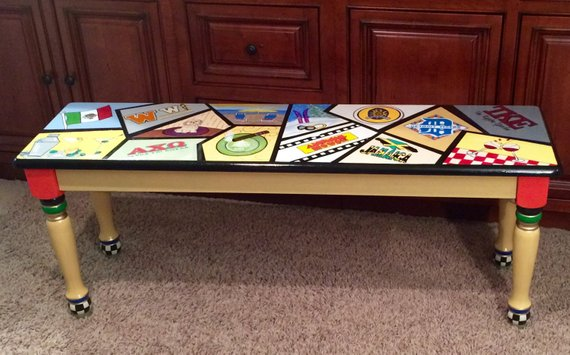 Personalized rectangle table standing on carpeted flooring.