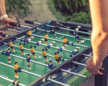 Foosball being played by two friends