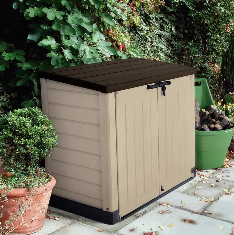 Garbage shed with cream and brown color.