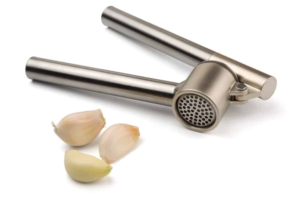 Metal garlic press.