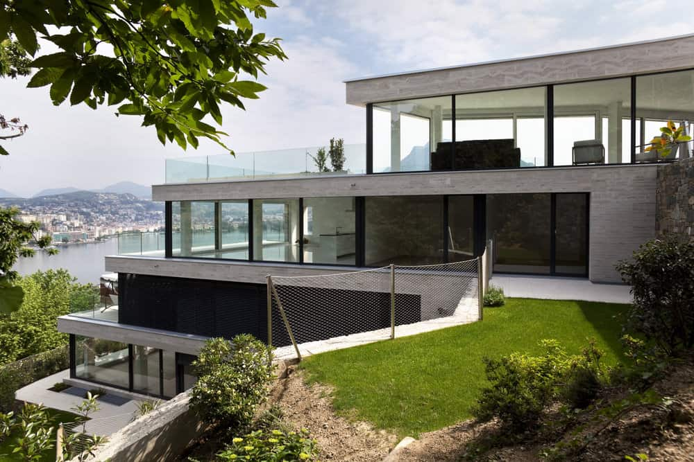 Cascading mansion down a cliff - 4 floors, most of which are floor-to-ceiling glass overlooking the water.