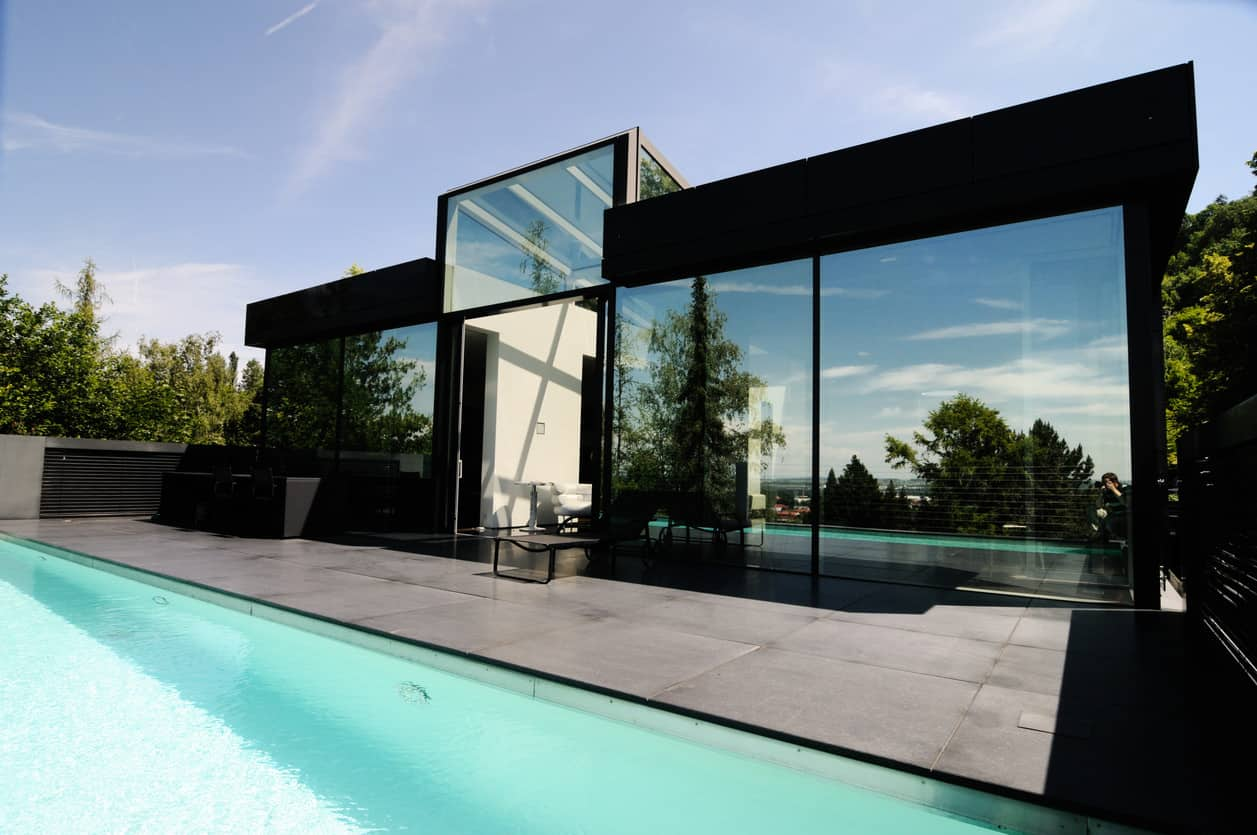 Small modern home that has mirrored exterior walls. Check it out. Interesting effect.