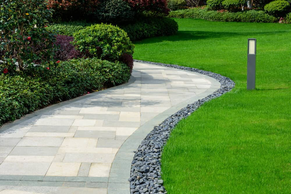 Lawn with arranged gravel on its edges.