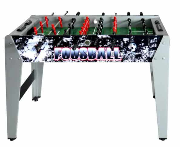 Gray foosball table with graphics on the sides.