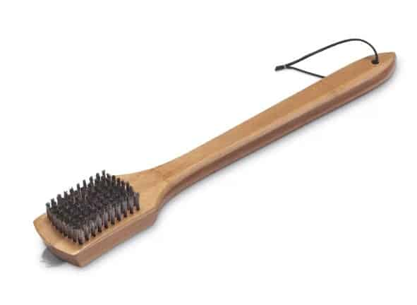 Grill brush with wooden base.