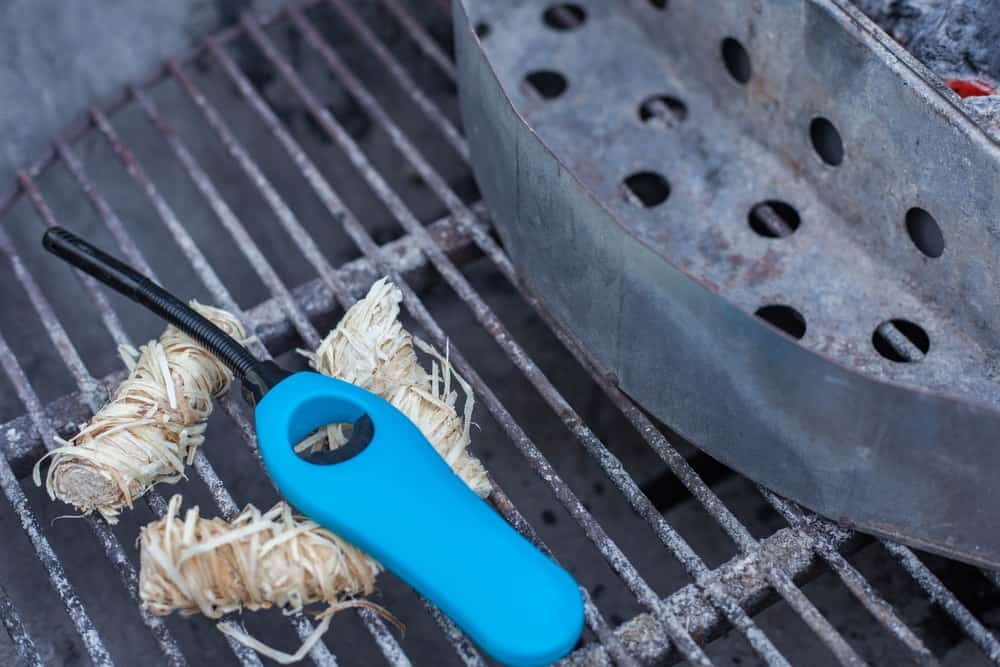 Grill lighter with blue handle.