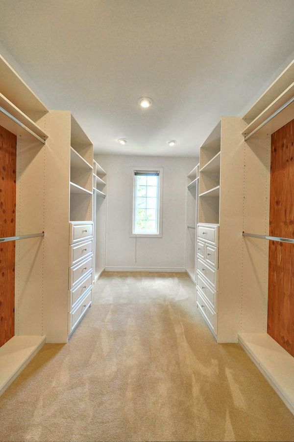 The closet features multiple cabinets and storage.