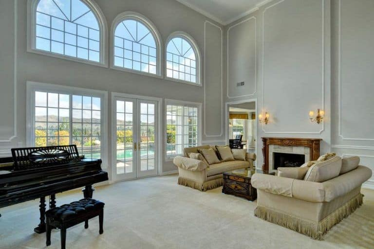 The Formal Living Room Boasts Classy Sofa Set Near The Fireplace.