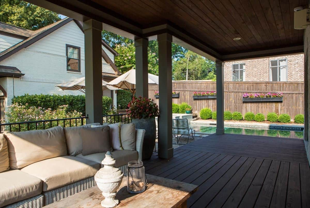 The Deck Extends From The Porch To The Patio.