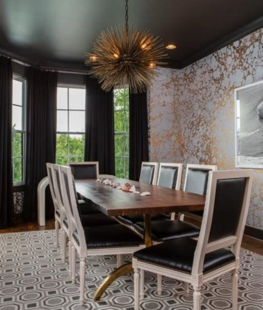 The dining room offers elegant dining experience with its beautiful wall design, lighting and rug along with its table set.