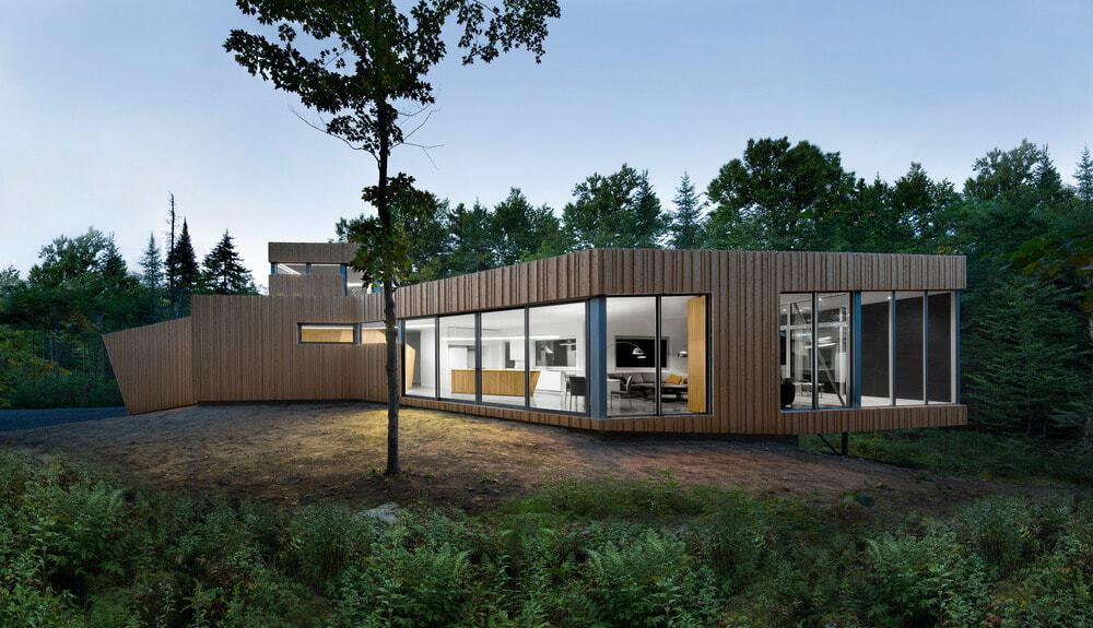 Modern house featuring a wooden exterior surrounded by mature trees.