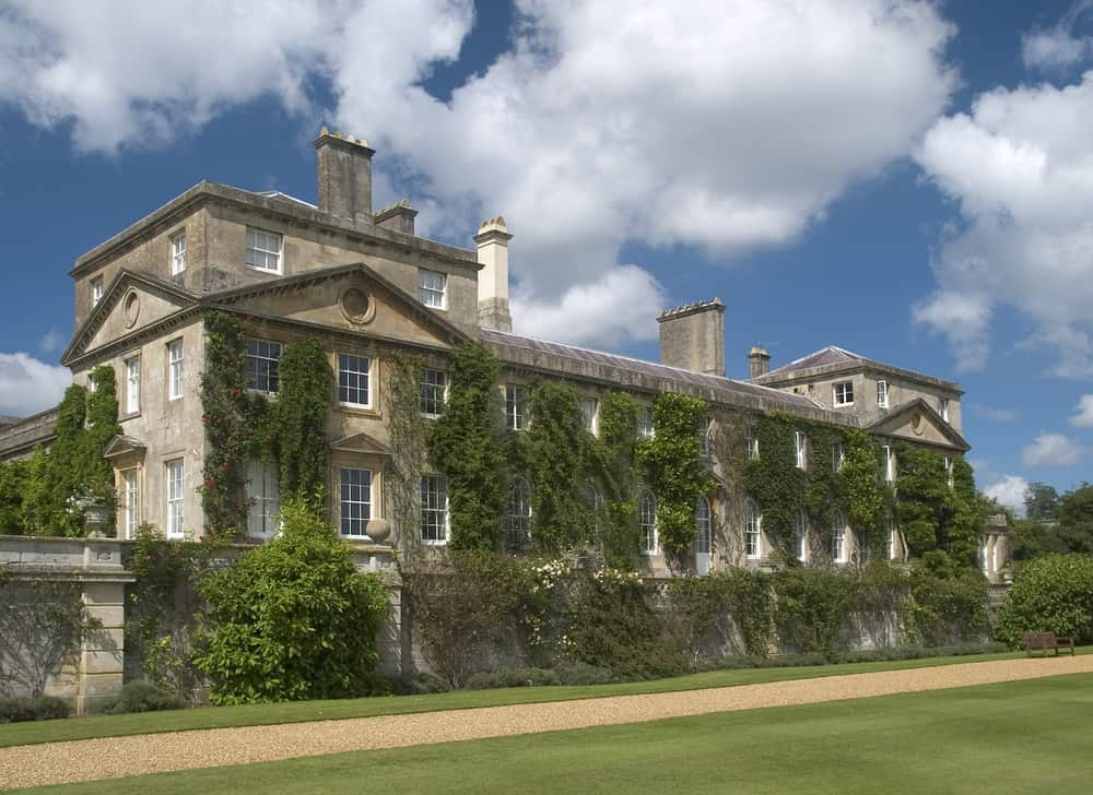 Bowood House in Wiltshire, England covered in ivy.