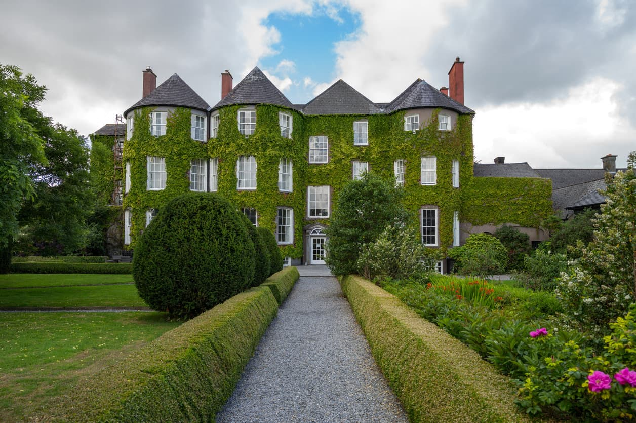 Kilkenny, Ireland: The ivy-covered Butler House and garden for Kilkenny Castle.