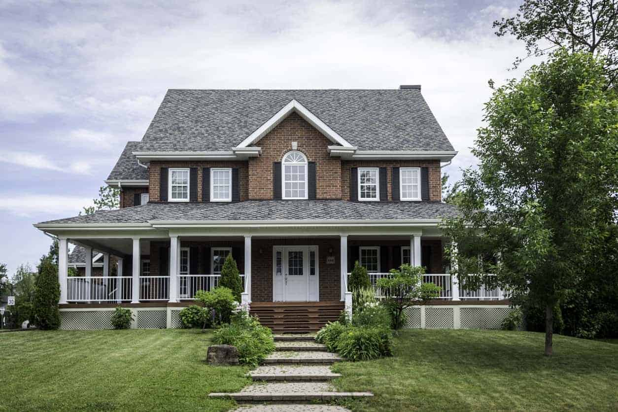 Another red brick home with dark gray exterior shutters. In this case the windows have plenty of white trim so the color scheme for the exterior is red, dark gray and white. It works.